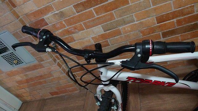 Bicicleta semi nova com marcha aro 26 - Foto 5
