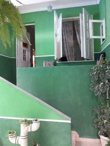 Casa de vila com dois quartos, reformada e pronta para morar!