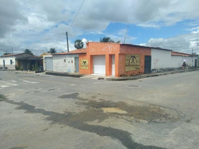 Casa plana com comércio no pq Soledade