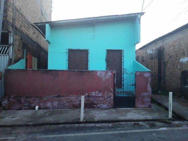 Casa em rua asfaltada
