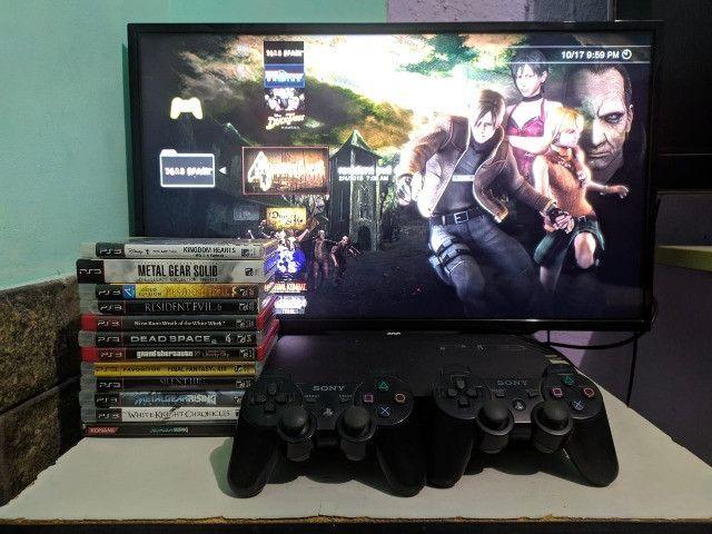 Playstation 3 slim + 2 controles originais + 12 jogos