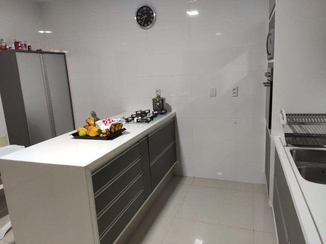 Excelente casa no Alphaville Litoral Norte II - 318 m² - 4/4 sendo 3 suítes - Casa nova - Foto 4