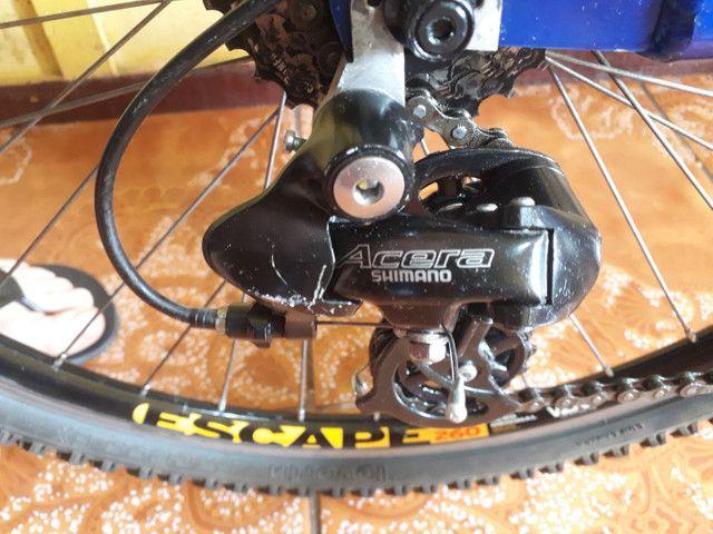 Bike semi nova quadro 21 aro 26 - Foto 5