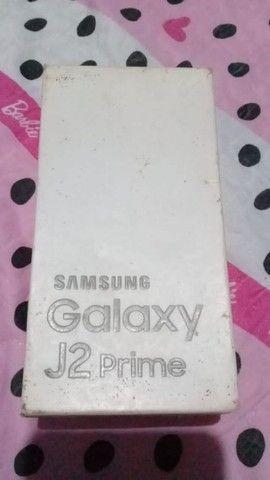 J2 prime bem conservado, pegando tudo acompanha caixa, antena, película, documento e capa - Foto 4