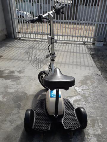 Triciclo elétrico com carregador - Foto 2