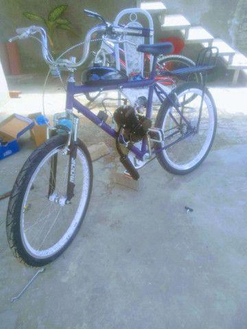 Bike motorizada troco em 50 tinha - Foto 2