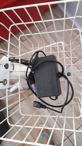 Triciclo elétrico com carregador - Foto 4