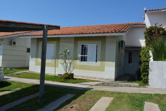 Casa 2 dormitórios, em condomínio fechado, playground, quadras de esportes