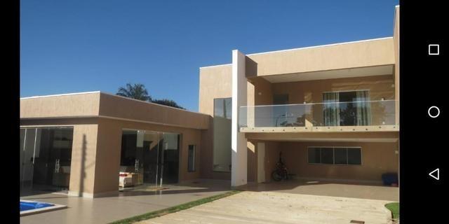 Linda casa com 3 suites em excelente localização no Condomínio Rk
