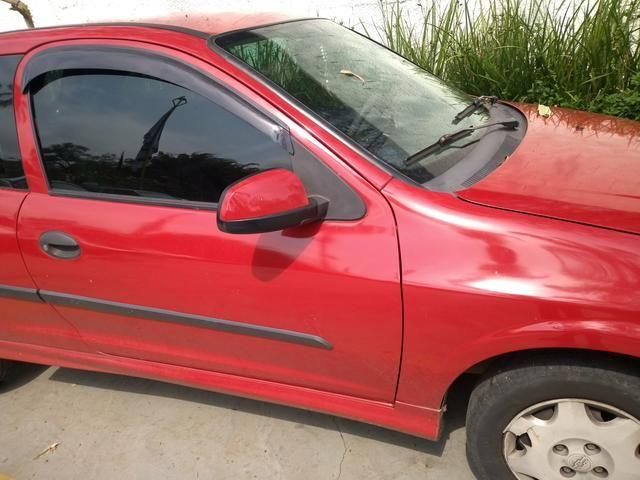 Celta GM Chevrolet vermelho - abaixo tabela - Foto 6