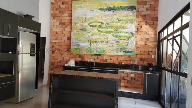 Imóvel com dupla aptidão, construção ampla, possuindo uma área total construída de 450 m² - Foto 5