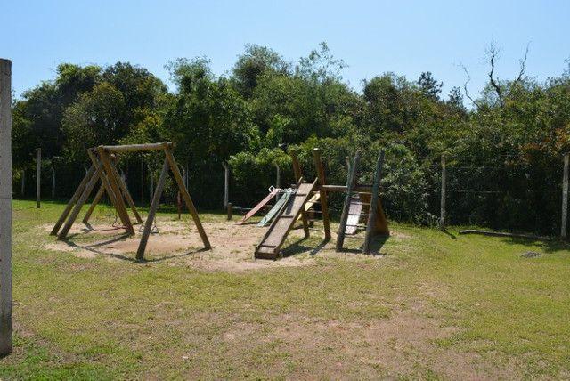 Casa 2 dormitórios, em condomínio fechado, playground, quadras de esportes - Foto 11