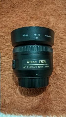 Nikon D5100 + Lente Nikkor 18-105 VR + Nikkor 35mm 1.8 + Bateria Extra - Foto 2