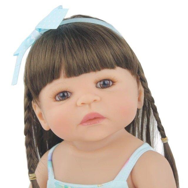 Bebê Reborn 55cm 100% silicone com unicórnio  - Foto 6