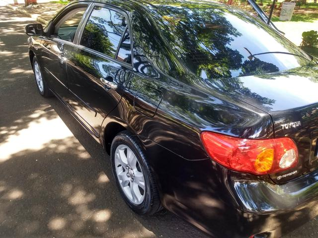 Corolla XEI automático 2010 com 101.706 mil km originais - Foto 5