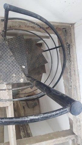 Escada caracol desapegando