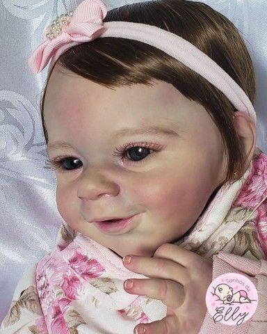Bebê reborn kit Sunny com enxovalzinho