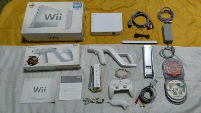 Nintendo Wii completo com arma e jogos originais  - Foto 2