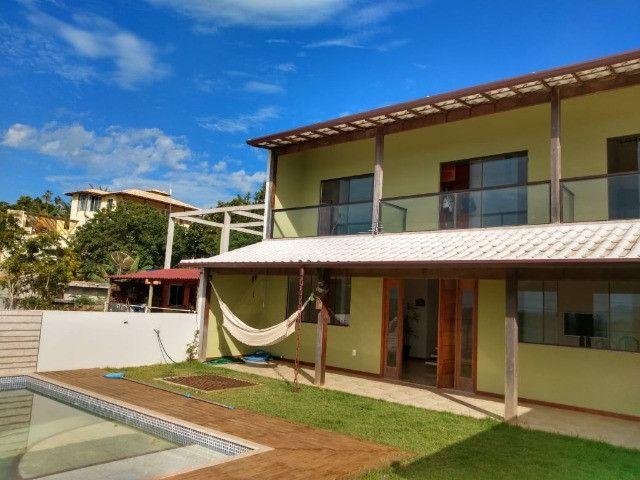 Casa com piscina, churrasqueira e perto da praia