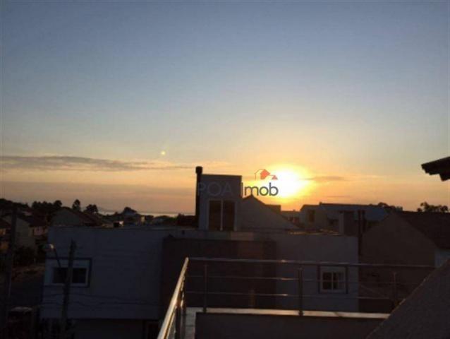 Casa residencial para locação, Guarujá, Porto Alegre - CA0128. - Foto 11