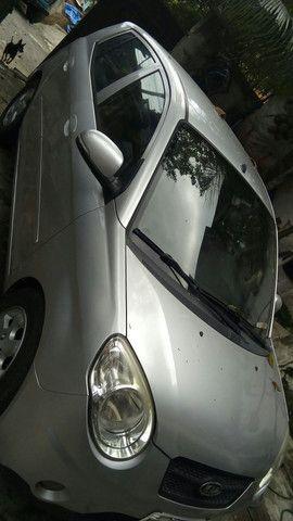 Uno 4 portas pneus novos placa nova - Foto 3