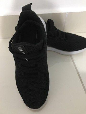 Tênis Nike semi novo original TAM 31 - Foto 2