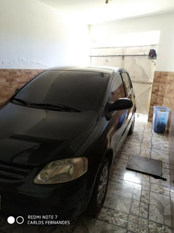 Vendo VW Fox 1.6 2005 4p Flex/GNV com ar/dh/trava - Foto 6