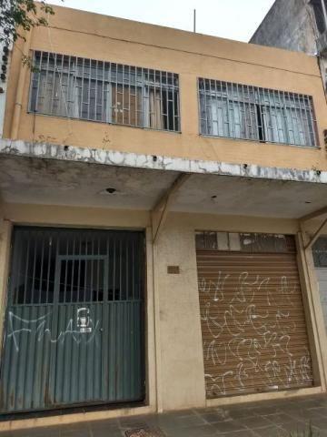 CNG 08, prédio de uso misto, com 02 aptos de 02 quartos e 02 lojas