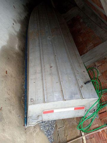 Barco de alumínio 5 metro e meio com motor seme novo