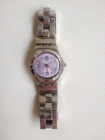 d80013c0bad Relógio Swatch Irony Ciel Clair Violet (fundo rosa) - Bijouterias ...