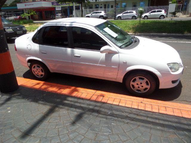 Corsa Sedan Classic LS 1.0 Flex 2012 Cor Branca, Trava, Alarme, Conservado - Foto 3