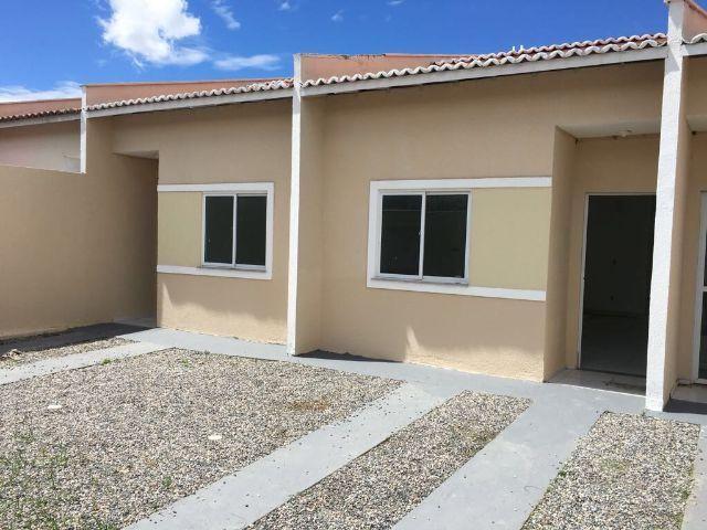 Documentação inclusa: 2 quartos, 2 banheiros, garagem, sala, coz americana, quintal, área