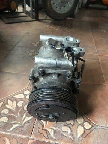 Compressor e condensador Jac J3