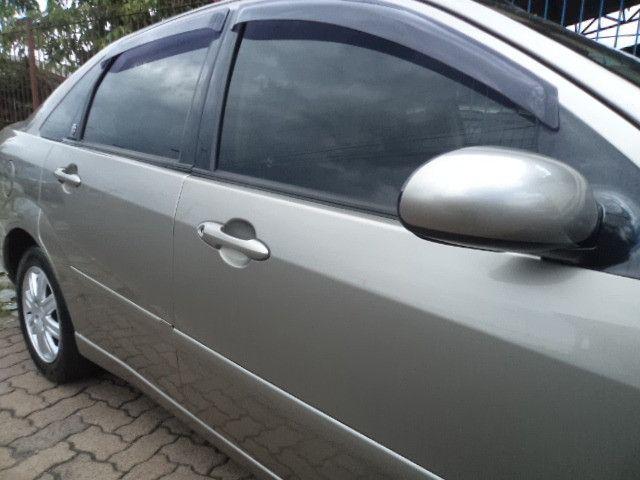 Focus Sedan Ghia 2005 - Foto 14