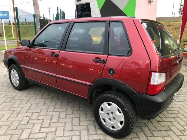 Fiat uno mille fire 4p completão com direção hidráulica pneus novos - Foto 3
