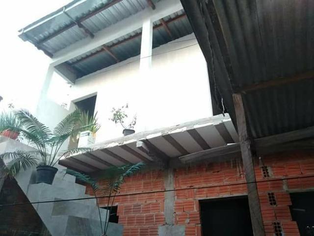 Casa, dois apartamentos e laje em construção - Foto 2
