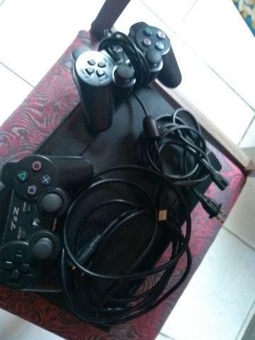 PS 3 slim 1 controles e 5 jogos - Foto 3