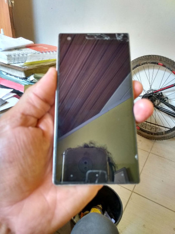Celular positivo, com botão de ligar estragado, tela quebrada funcionando - Foto 2