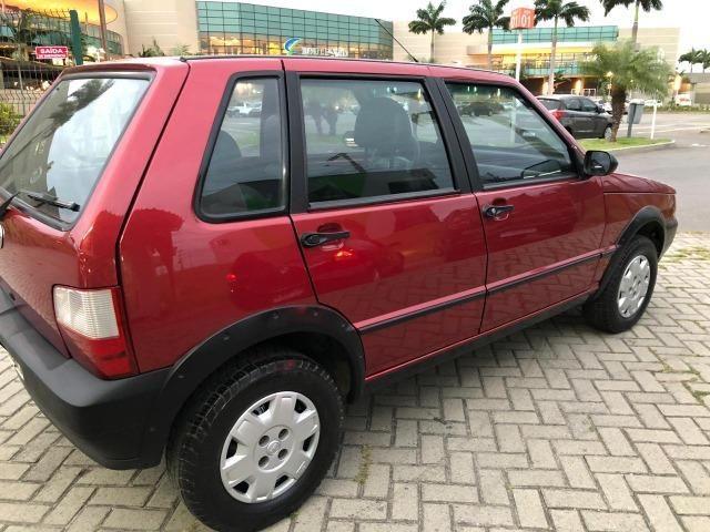 Fiat uno mille fire 4p completão com direção hidráulica pneus novos - Foto 5