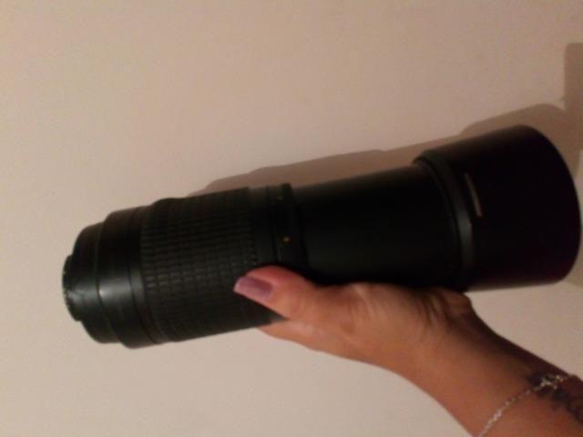 Vendo teleobjetiva foco manual Nikon 70-300mm com para sol incluído 500,00