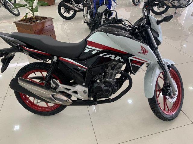 Honda ti'tan s entrada de 1000 reais leia