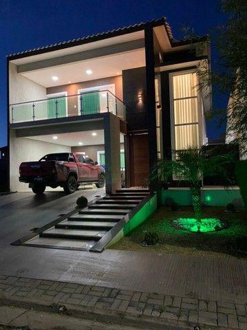 Belíssima casa com 4 suites em condomínio de luxo - Foto 2