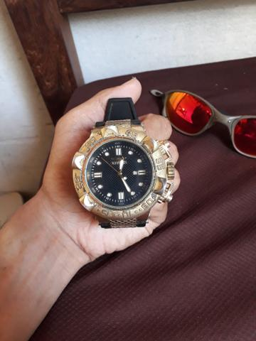 56c51aa4b31 Óculos juliete e Relógio Invicta - Bijouterias