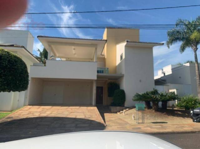 Casa estilo sobrado alto padrão em cond. fechado com 4/4 à venda, 328m² por R$ 1.460.000 -
