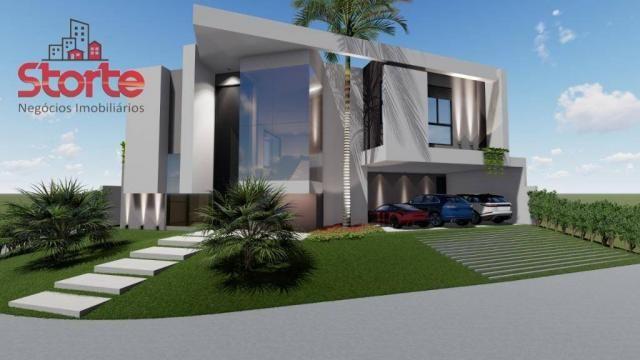 Casa estilo sobrado alto padrão em cond. fechado com 5 suítes à venda, 381m² por R$ 2.500.