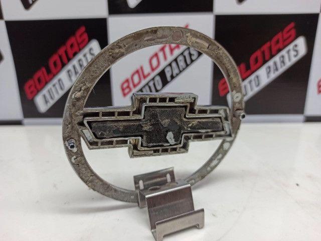 Emblema gravata traseiro Corsa Hatch 02/. - Foto 5