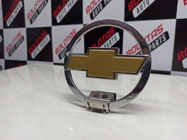 Emblema gravata traseiro Corsa Hatch 02/. - Foto 4