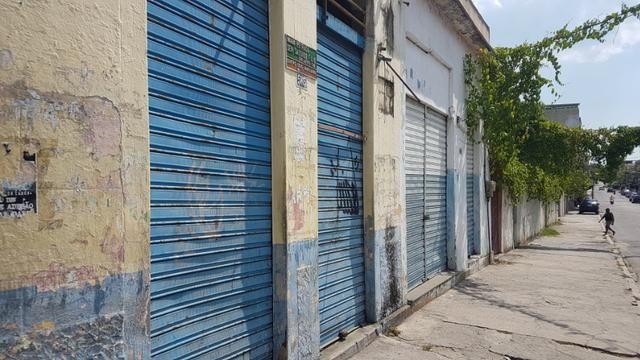 Terreno com alguns imóveis em Nilópolis na rua Senador Salgado Filh