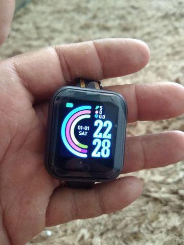 Smartwatch D-20 + pulseira grátis - Foto 5