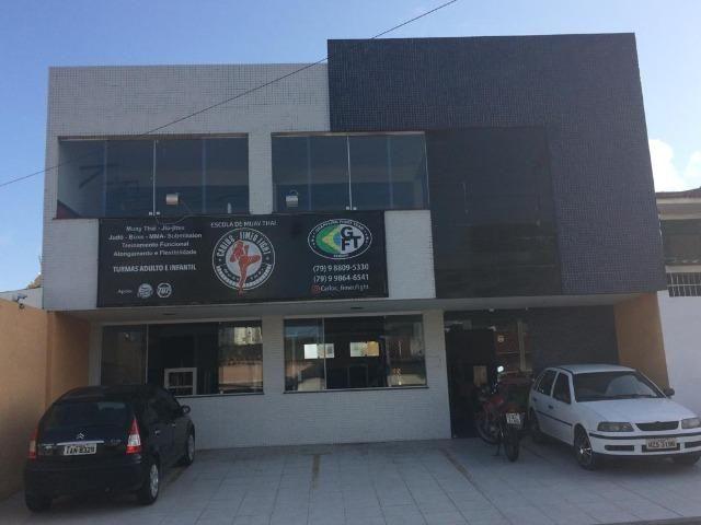Casa a venda com comércio no Bairro Luzia